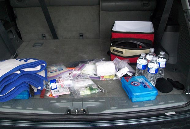 emergency supplies in a car trunk