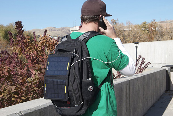 charging a solar panel on your back